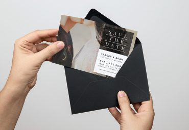 Printed party invitation in envelope